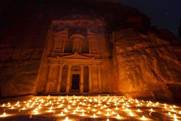 The Treasury, known locally as Al Khazneh, illuminated by hundreds of candles, located in the UNESCO World Heritage Site of Petra, or Rose-Red city, which was the 6th century capital city of the Nabataeans.