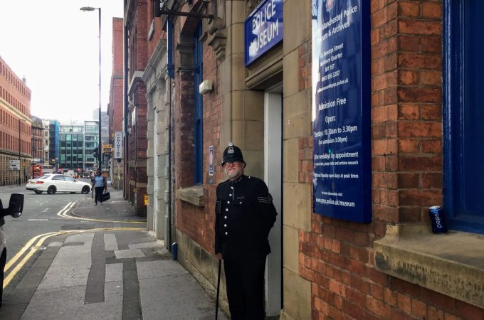 Policeman stadning outside the Police Museum on Newton Street Manchester