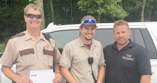 Johnson County Sheriff Charles Harner, K9 officer Cyle Harner and The Resort at Egyptian Hills managing partner Micah Merrill.