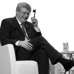 Prime Minister Stephen Harper smiles during a question and answer period following a luncheon speech Friday, November 15, 2013 in Montreal. THE CANADIAN PRESS/Paul Chiasson