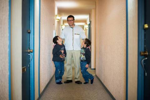 drury-martin-in-the-hallway-of-his-old-building-with-his-two-sons