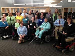 WeCo's testers, staff and board members assembed for a group photo in their office.