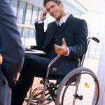 Businessman, who is in a wheelchair, During a Meeting