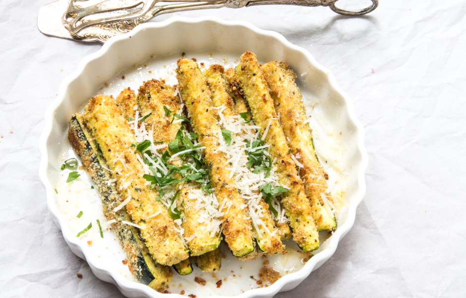 Easy side dish: Baked zucchini sticks coated in Parmesan, flavored breadcrumbs, and herbs.