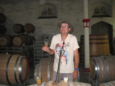 Stuart Bourne, Sr. Winemaker, tasting from the barrel