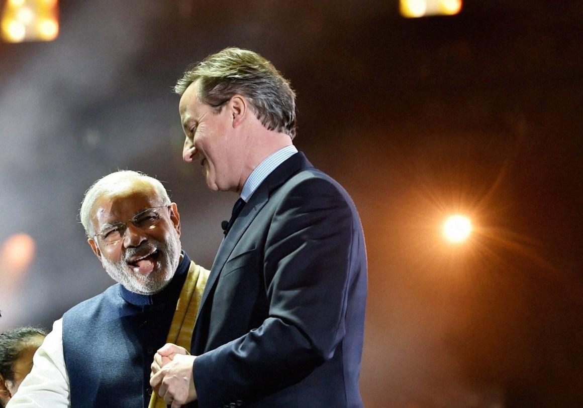 Prime Minister Narendra Modi with his UK counterpart David Cameron at Wembley Stadium  in London on Friday. Credit: PTI Photo