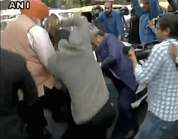 BJP MLA OP Sharma thrashing one of the JNU students who were protesting against the arrest of JNUSU president Kanhaiya Kumar