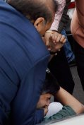 BJP MLA OP Sharma thrashing CPI leader Ameeque Jamai who was protesting against the arrest of JNUSU president Kanhaiya Kumar . Credit: PTI
