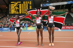 From left, Kenya's Florence Kiplagat, Emily Chebet and Joyce Chepkirui celebrate victory at the Commonwealth Games in Glasgow. Credit: Reuters/Suzanne Plunkett