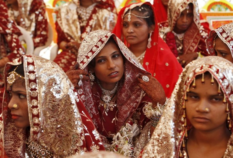 Muslim brides wait for the start of a mass marriage ceremony in Ahmedabad, India, October 11, 2015. Photo credit: Reuters/Amit Dave.
