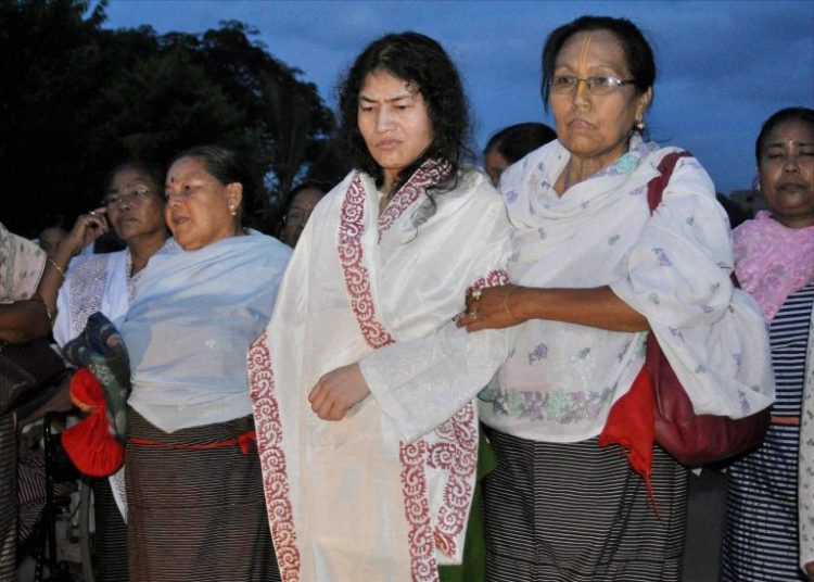 Imphal: Irom Sharmila coming out of JNIMS Security ward after her release in Imphal on Wednesday following a court order. PTI Photo (PTI8_20_2014_000230B)