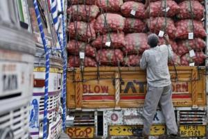 A labourer prepares to unload sacks of potatoes from a truck at a wholesale vegetable and fruit market in New Delhi July 2, 2014. REUTERS/Anindito Mukherjee/Files