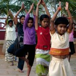 The children of Odanadi practicing tree pose