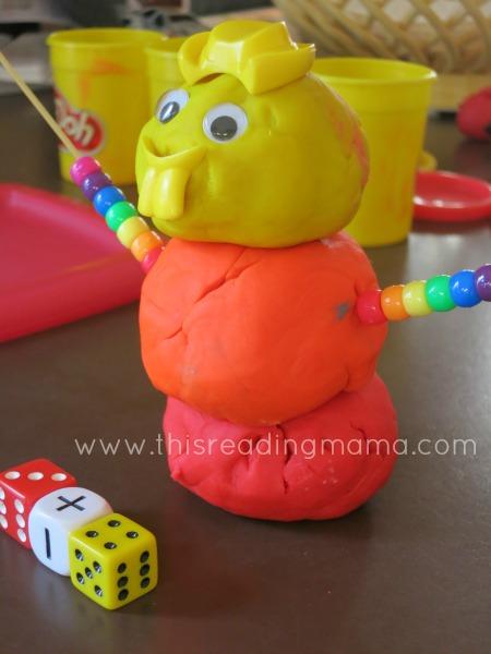 Adding pony beads to playdough snowmen ~ math game | This Reading Mama