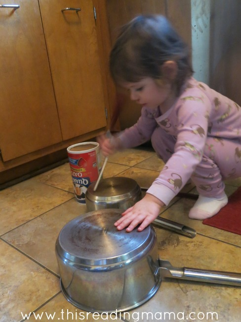 toddlers can play with pots and pans in the kitchen