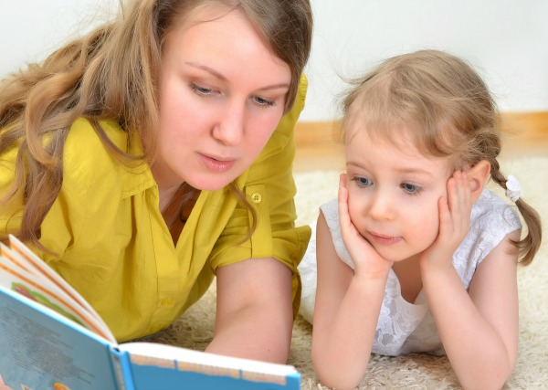 parent reading aloud to child