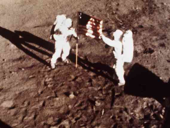 """""""Hey Neil - let's totally give this flag to that douchebag who said we couldn't make it to the moon!"""""""