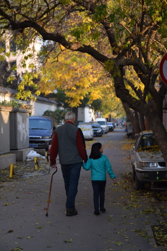 Li Li and Poppy out for an early morning walk in the Hutong.