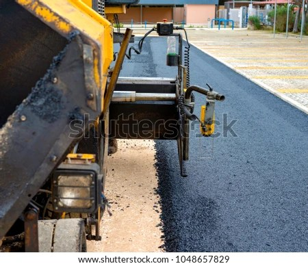 pavement machine laying fresh asphalt bitumen stock photo royalty