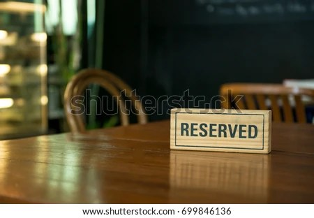 Reserved Sign On Top Wooden Table Stock Photo Edit Now
