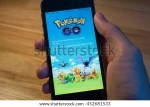 Person Holding Mobile Phone And Showing Pokemon Go Website Pokemon Go