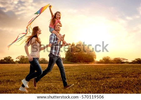 Girl Playing In Water Wallpaper Family Running Through Field Letting Kite Stock Photo
