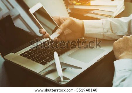Business Traveller Using His Phone Book Stock Photo (Royalty Free - business phone book