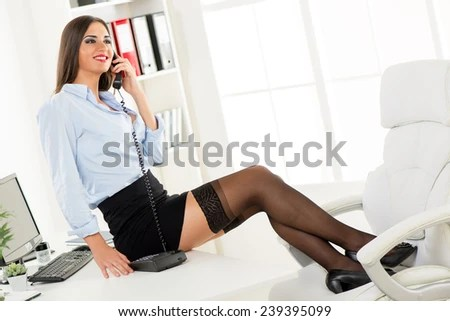 Young Pretty Businesswoman Short Skirt Sitting Stockfoto
