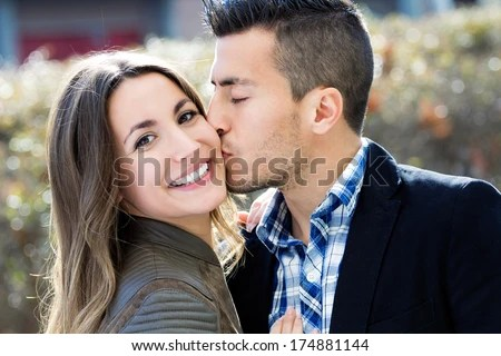 Portrait of young couple in love on the street - stock photo
