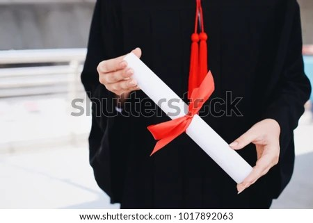 Young Student Woman Holding Diploma Certificate Stock Photo (Royalty - Graduation Certificate Paper