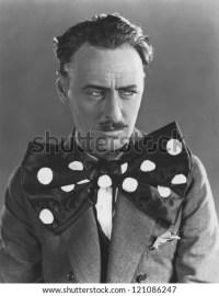 Man in oversized bow tie - stock photo