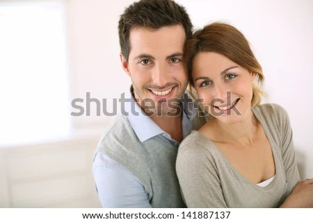 Portrait of smiling loving couple - stock photo