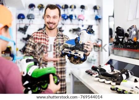 Smiling European Male Shop Assistant Helping Stock Photo (Edit Now - shop assistan