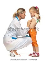 Female Doctor Examining A Little Child On A White Background Stock