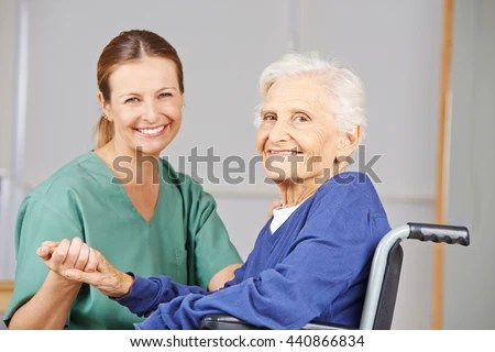 Geriatric Nurse Senior Woman Wheelchair Smiling Stock Photo