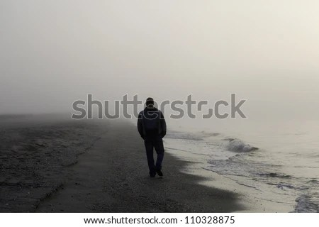Sad Girl With Red Rose Wallpaper Lonely Man Walking On A Foggy Beach Stock Photo