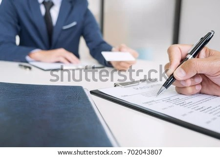 Interviewer Board Reading Resume During Job Stock Photo (100 Legal - interviewer resume