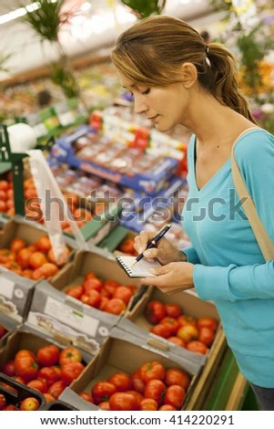 Woman Listing Supermarket Buying Tomatoes Stock Photo 414220291 - supermarket listing