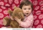 Little Girl Making Bed