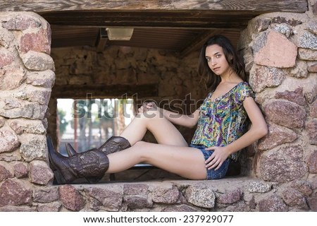 Girls Legs In Skinny Jeans Royalty Free Stock Photography