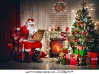 Santa Fireplace Near Sitting Stock Images, Royalty-Free ...