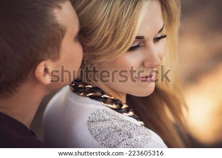 young couple laying on park lawn - stock photo