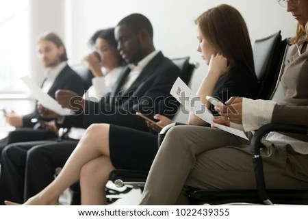 Multiethnic Applicants Sitting Queue Preparing Interview Stock Photo