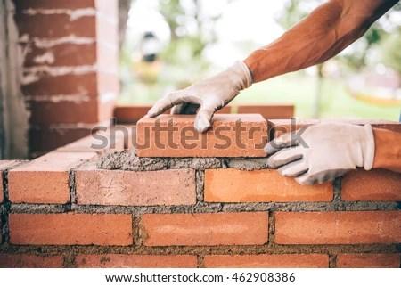 Brick Laying Stock Photos, Royalty-Free Images & Vectors