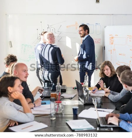 Relaxed Informal Business Startup Company Meeting Stock Photo (Safe