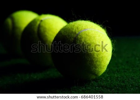 Tennis Ball Isolated On Black Dramatic Stock Photo 686401558 - why is there fuzz on a tennis ball