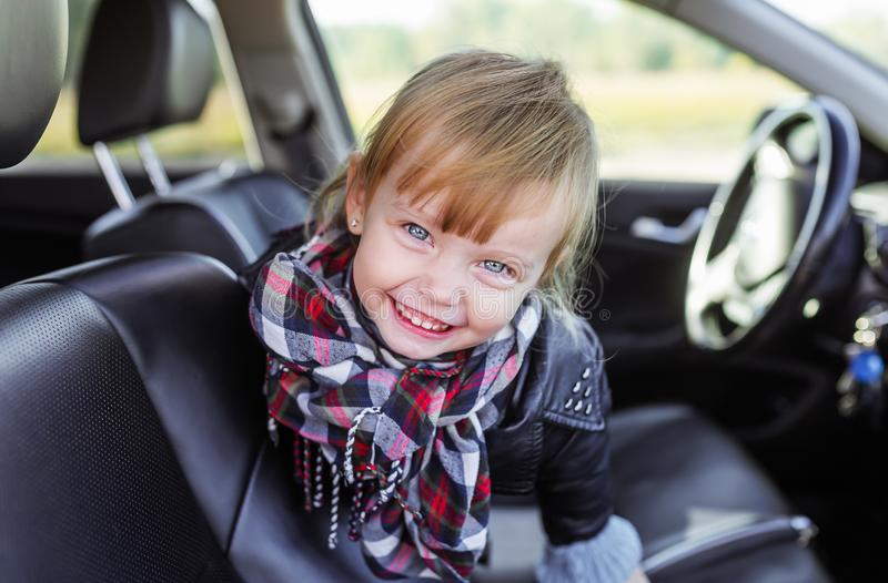 Newborn Car Seat Road Trip Adorable Little Girl Sitting In Car Seat Stock Photo