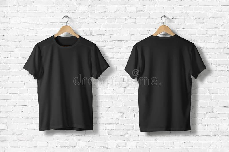 Blank Black T-Shirts Mock-up Hanging On White Wall, Front Side View