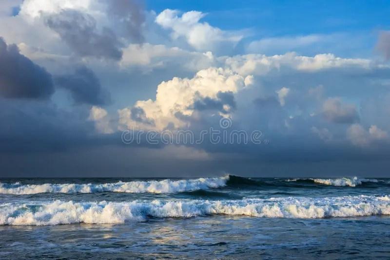 Breaking Ocean Waves Under Colorful Cloudy Sky Stock Image - Image