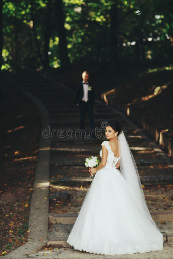Bride Waits On The Garden Footsteps While Groom Stands On The Ba - ba stands for